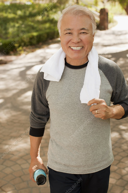 Older man smiling during workout
