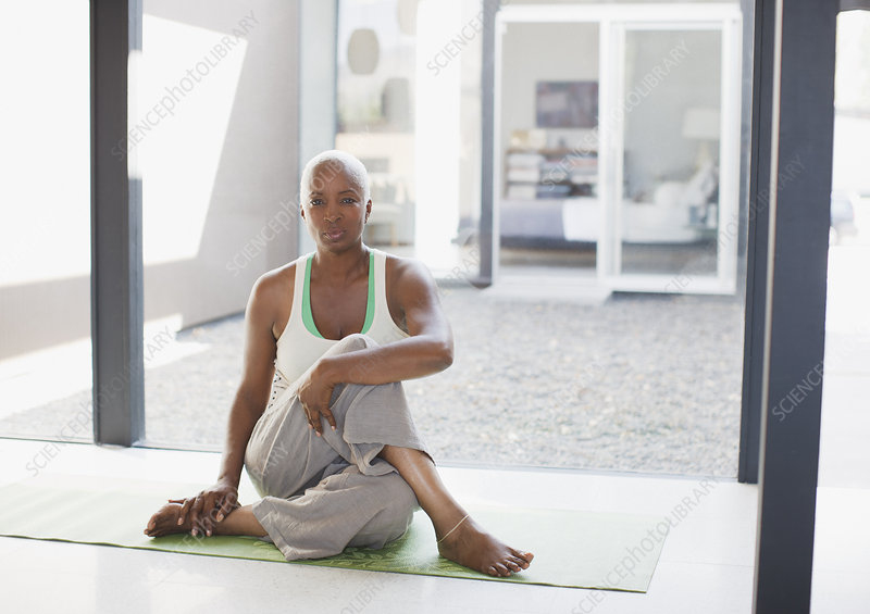 Older woman stretching on yoga mat