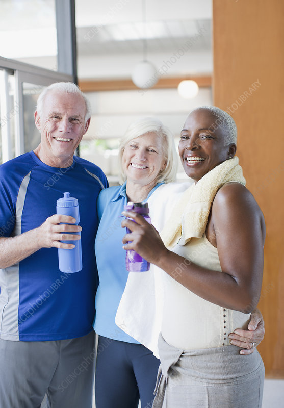 Older people drinking water after workout