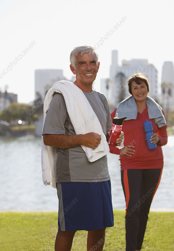 Older couple drinking water after workout