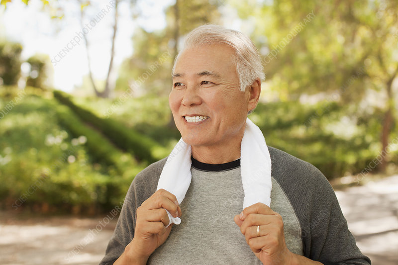 Smiling older man resting after workout