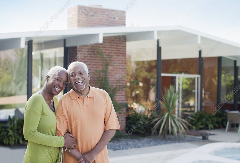 Older couple smiling in backyard