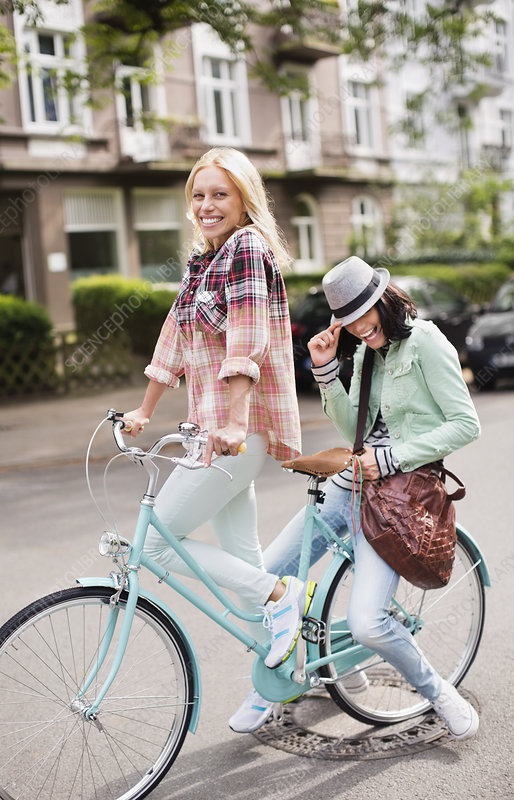 Women riding bicycle together