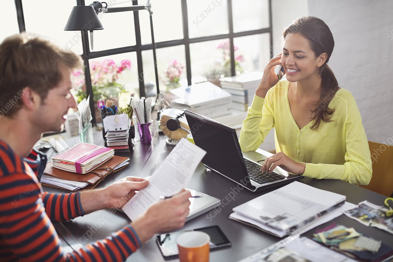 Couple working together at desk