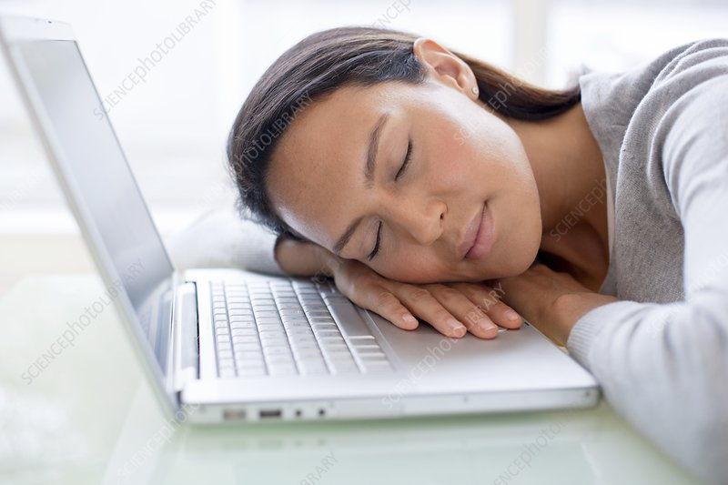 Young woman asleep on laptop