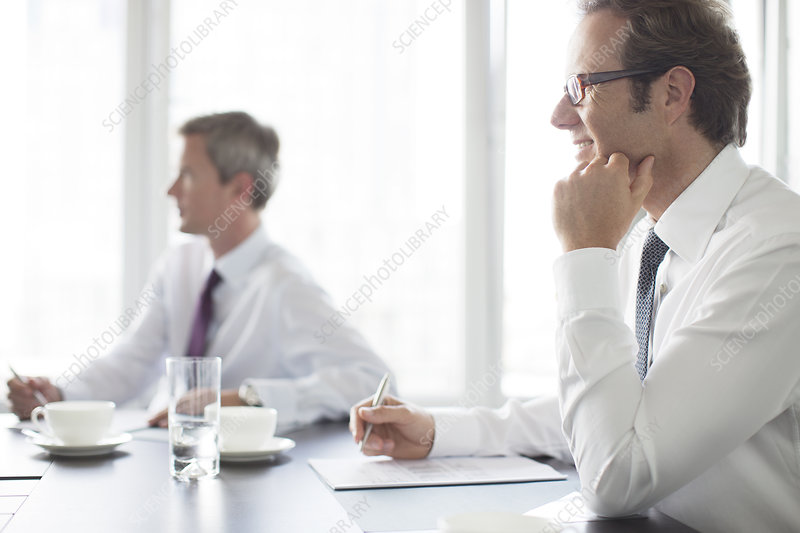 Businessmen sitting in meeting