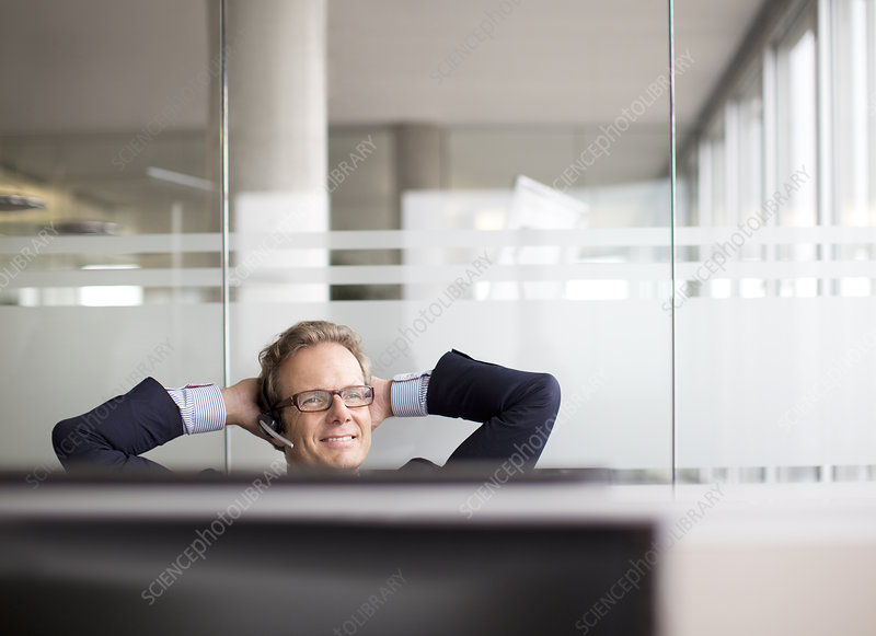 Businessman talking on headset in office