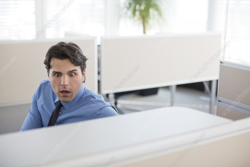 Surprised businessman working in office