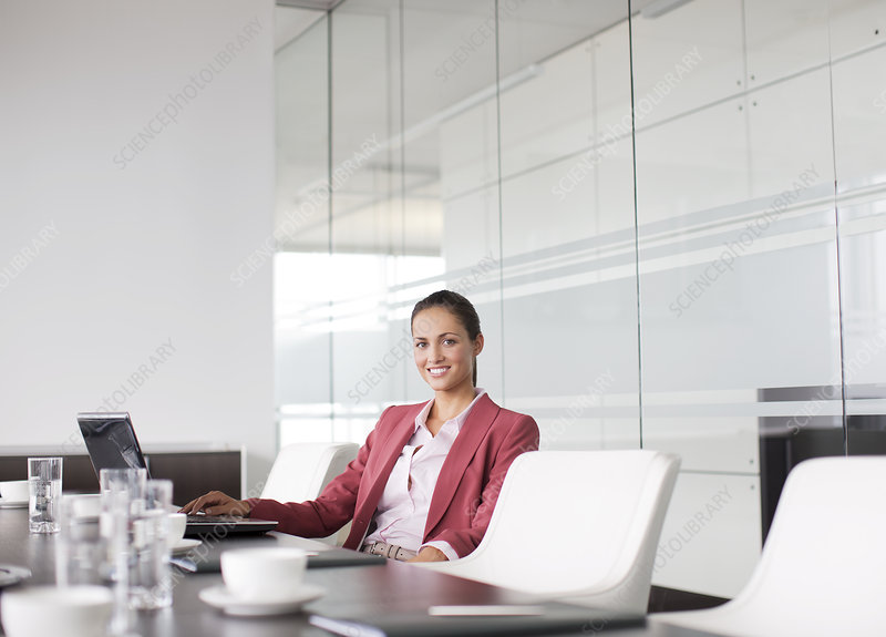 Businesswoman smiling at meeting table