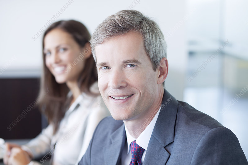 Businessman smiling in meeting