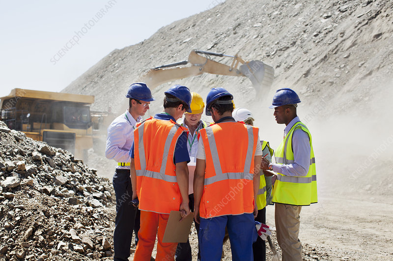 Workers talking in quarry