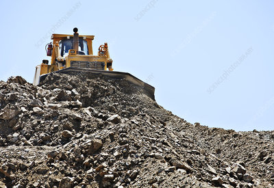 Bulldozer working in quarry