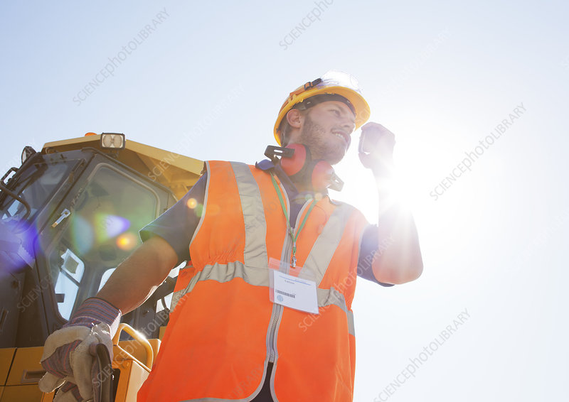 Worker using walkie-talkie on site