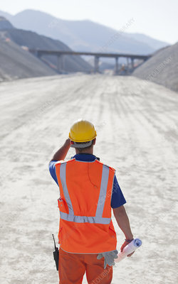 Worker standing on road in quarry