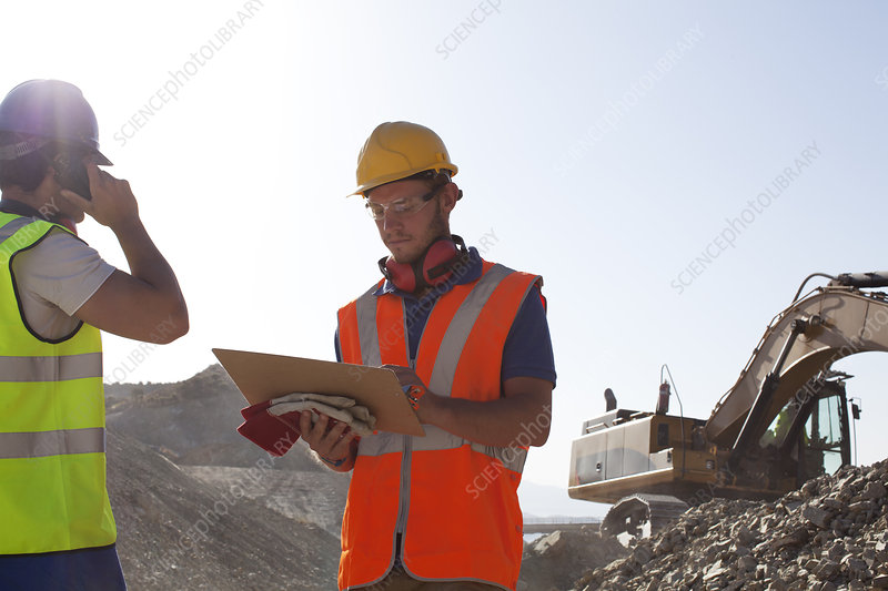 Workers standing in quarry
