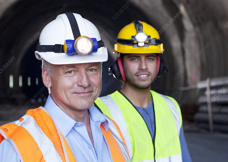 Businessman and worker smiling together