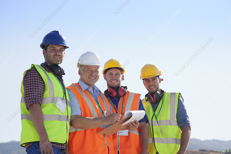 Businessman and workers smiling on site