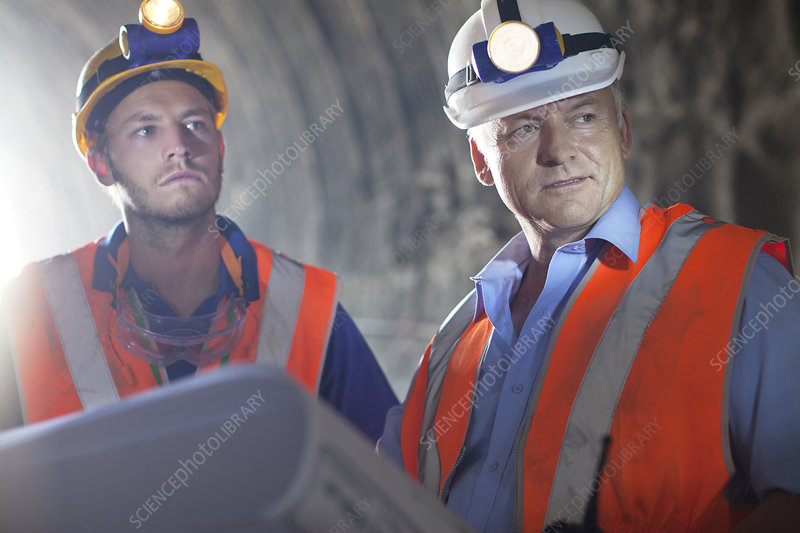 Worker and businessman with blueprints