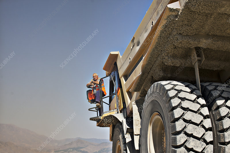 Worker standing on machinery
