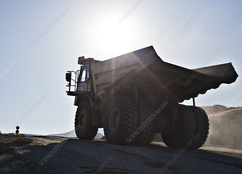 Silhouette of truck in quarry