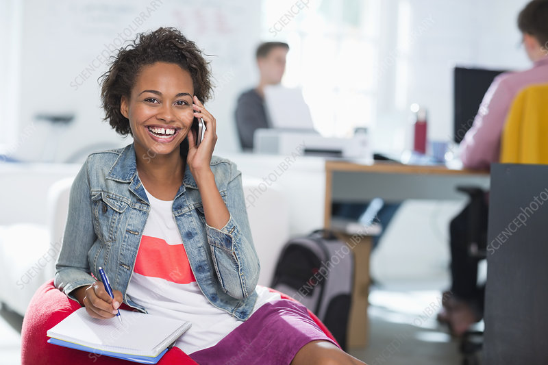Woman taking notes on cell phone