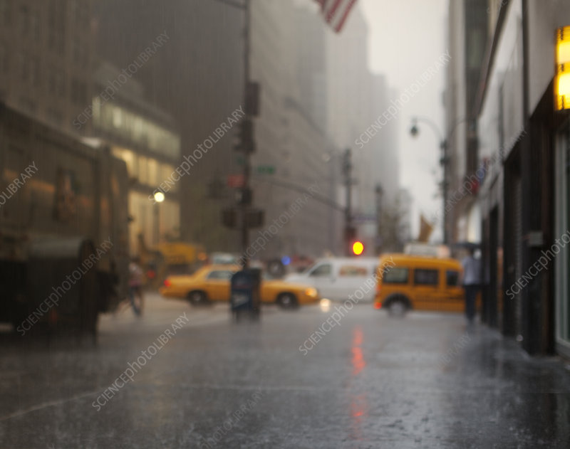 Blurred view of rainy city street