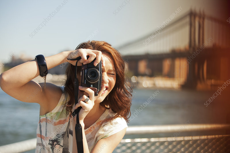 Woman taking picture by city cityscape