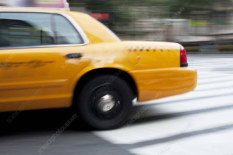Blurred view of taxi on city street