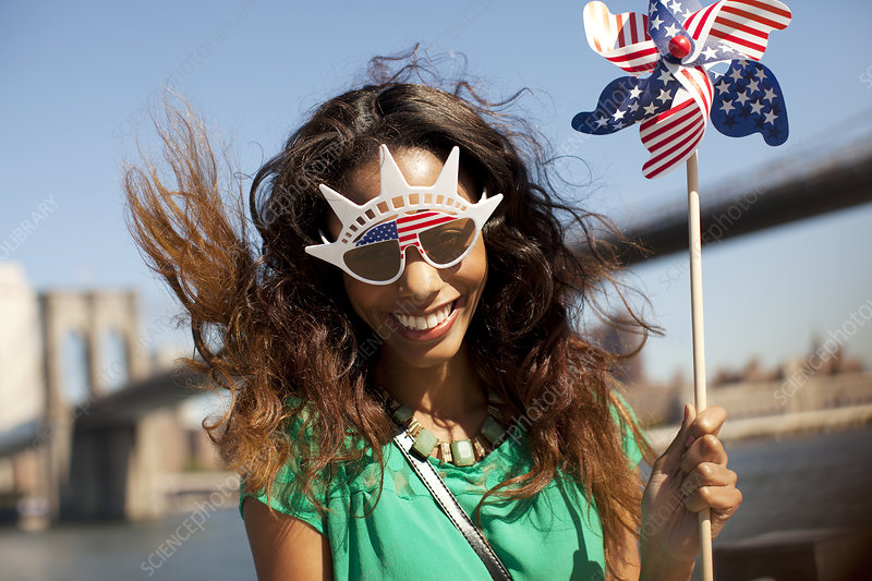 Woman in novelty sunglasses with pinwheel