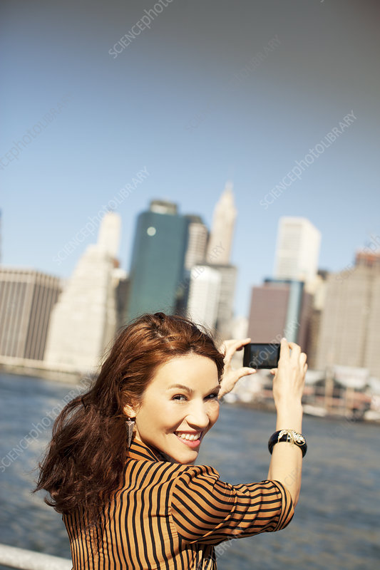 Woman taking picture of city cityscape