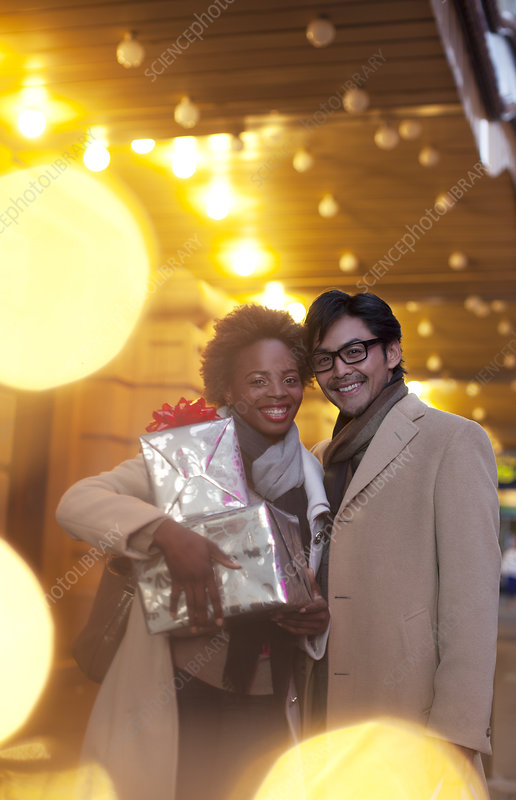 Couple carrying wrapped gifts