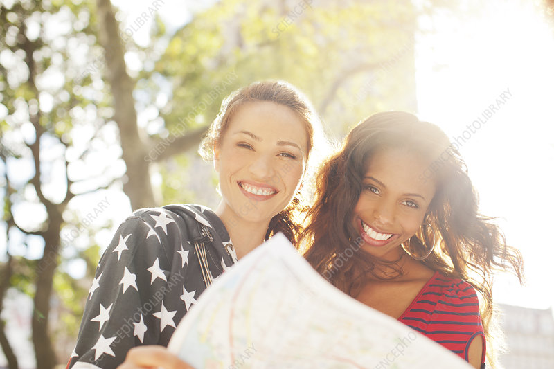 Women reading map outdoors