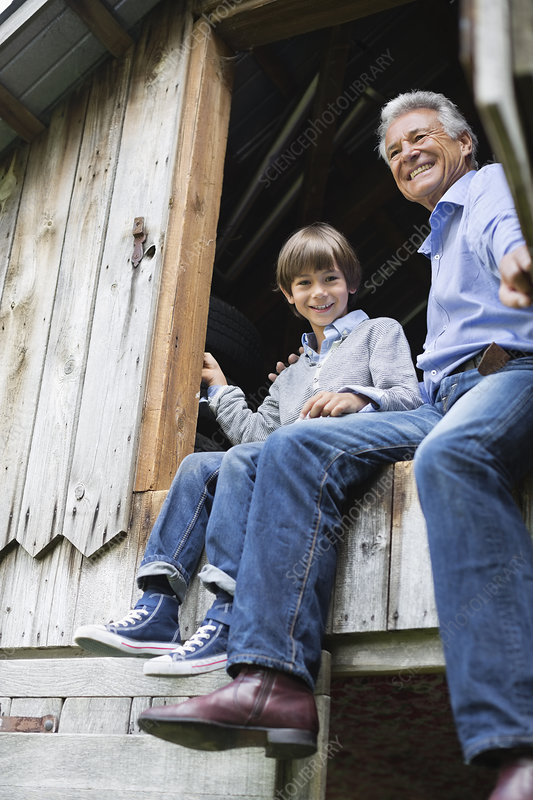 Man and grandson sitting in doorway