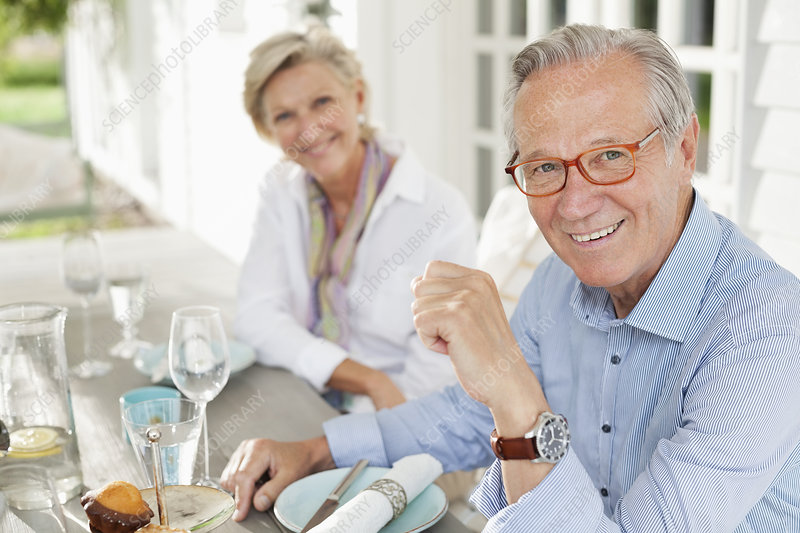 Couple smiling at table together