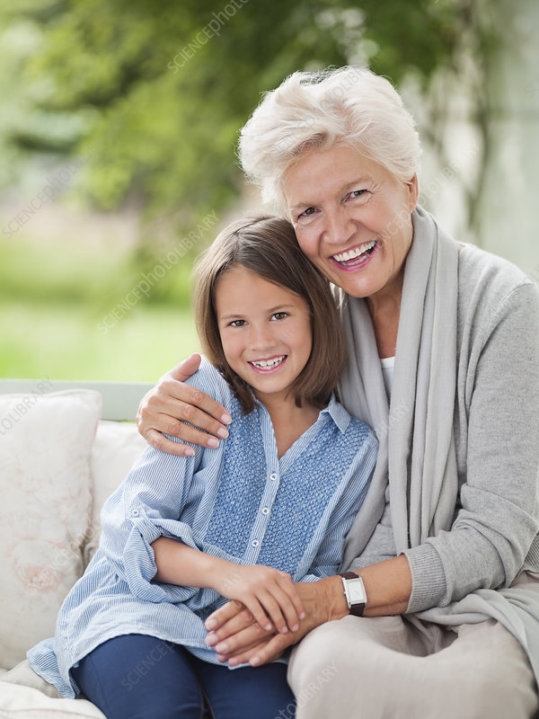 Woman and granddaughter smiling