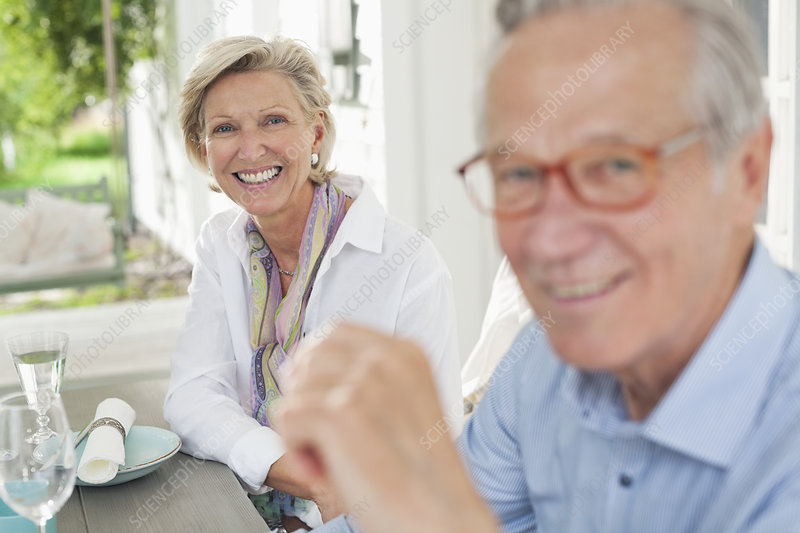Couple smiling together at table