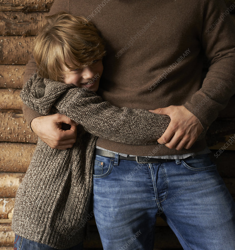 Smiling son hugging father
