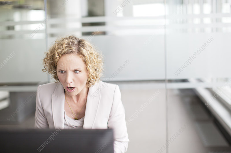 Surprised businesswoman working in office