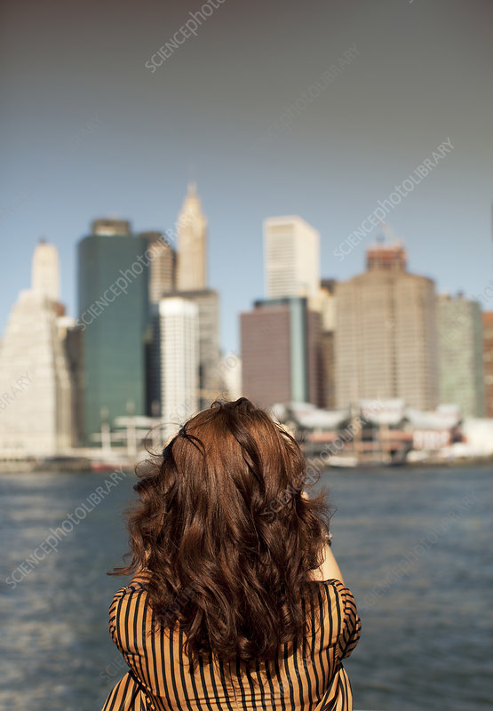 Woman taking picture of urban cityscape