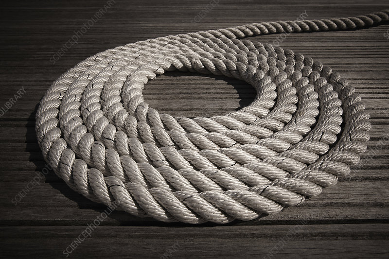 Rope coiled in circle on boardwalk