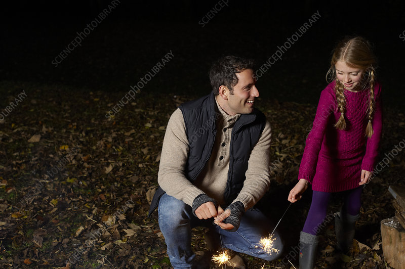 Father and daughter with sparklers