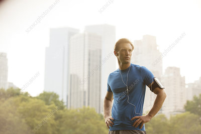 Runner standing in urban park