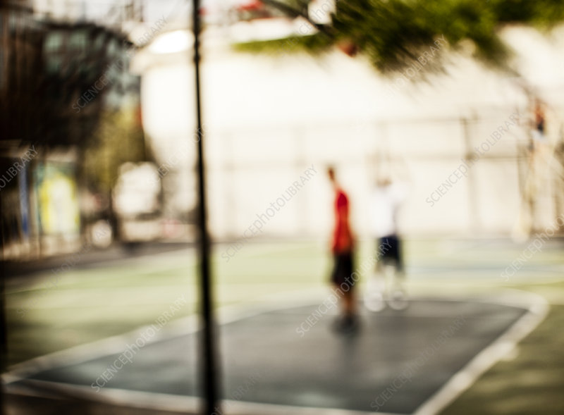 Blurred view of men on basketball court