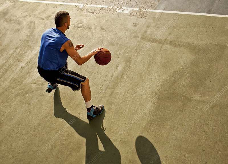 Man playing basketball on court