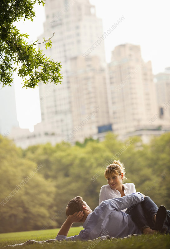 Couple relaxing in urban park