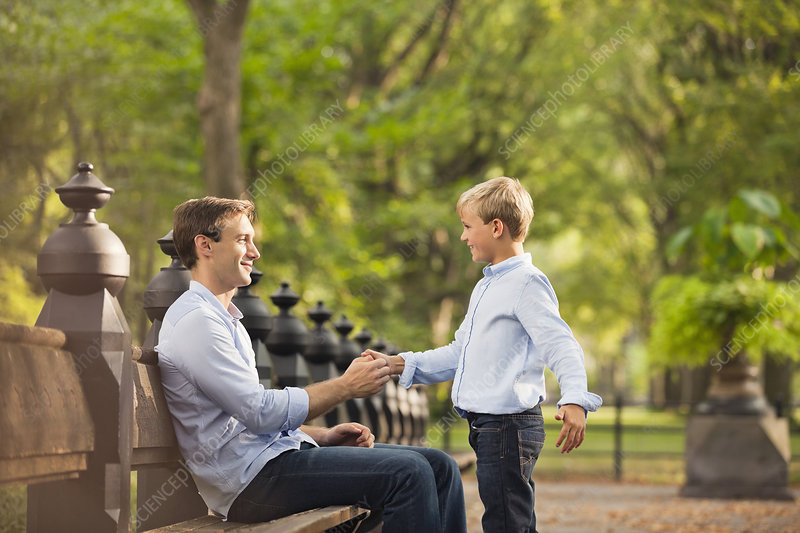 Father and son in urban park