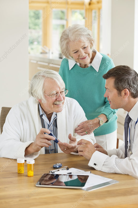Doctor talking with patient and wife