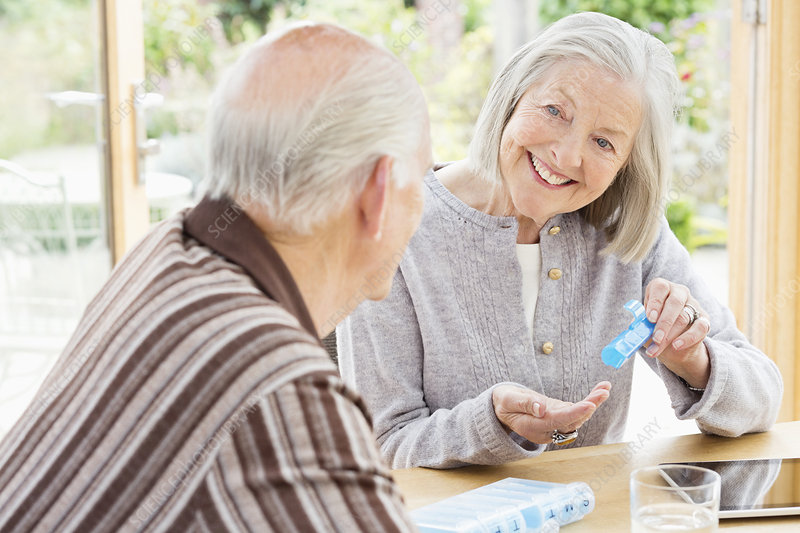 Caucasian couple organizing pills