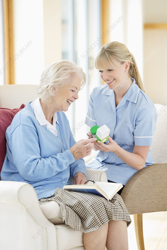Caregiver talking with older woman