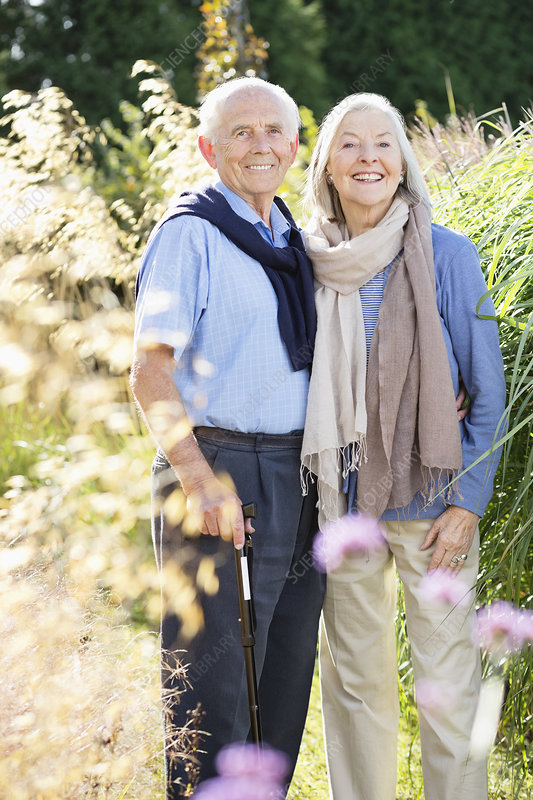 Older couple standing together outdoors